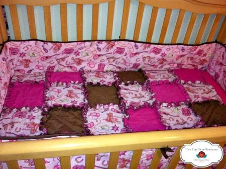 a rag quilt crib set for a baby girl in hot pink cowgirl theme