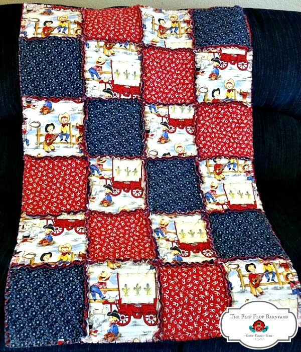 a child's rag quilt with a cowboy theme