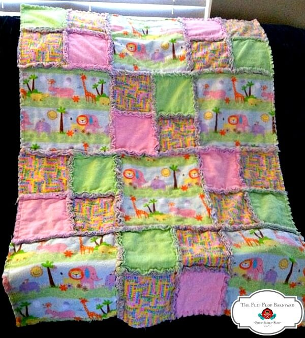 a baby rag quilt with pastel colors and a jungle theme