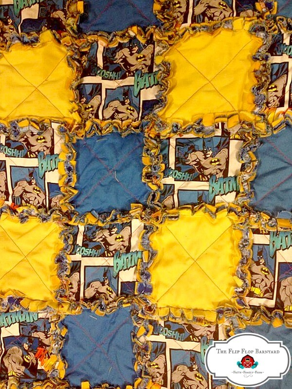 a child's rag quilt in a Batman theme