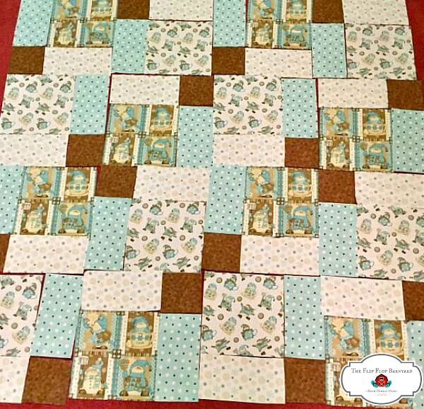 photo of cut quilt blocks laid out in the pattern to assemble them.
