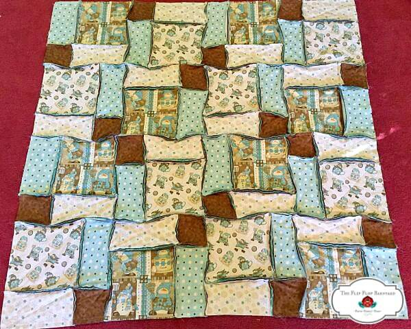 a photo of completely assembled rag quilt before edges being ragged
