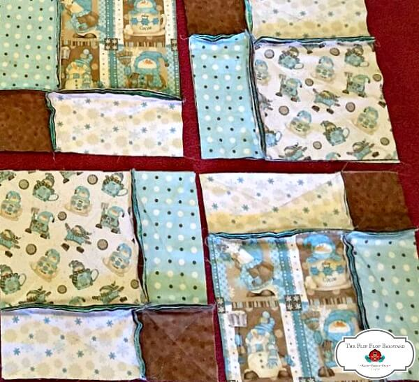 a photo showing hoe to sew rag quilt squares with the seams on top.