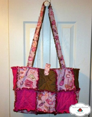 a diaper bag made with rag quilt style. The theme is hot pink cowgirl