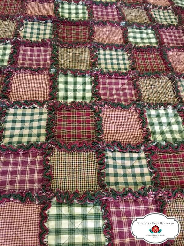 photo of a plaid rag quilt in green, red, and tan colors