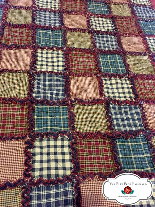 photo of a plaid rag quilt in green, blue, and burgundy colors