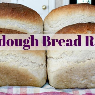 """photo of 4 loaves of sourdough bread with the words """"sourdough bread recipe"""""""